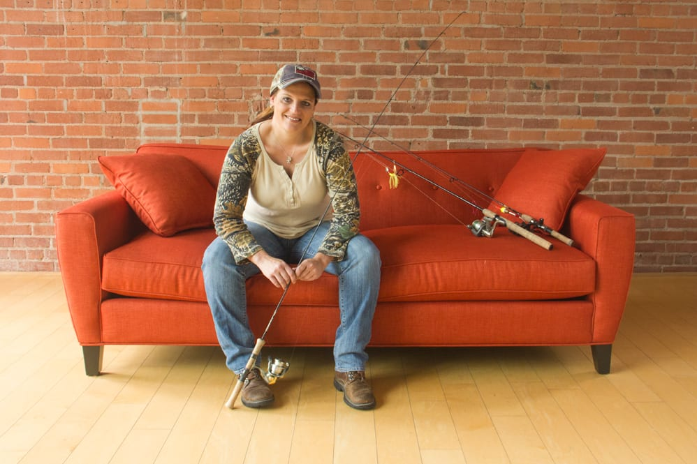 Cinda on couch with fishing gear