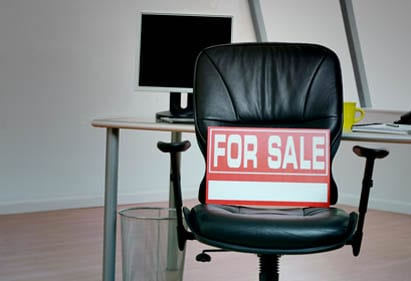 For sale sign on office chair